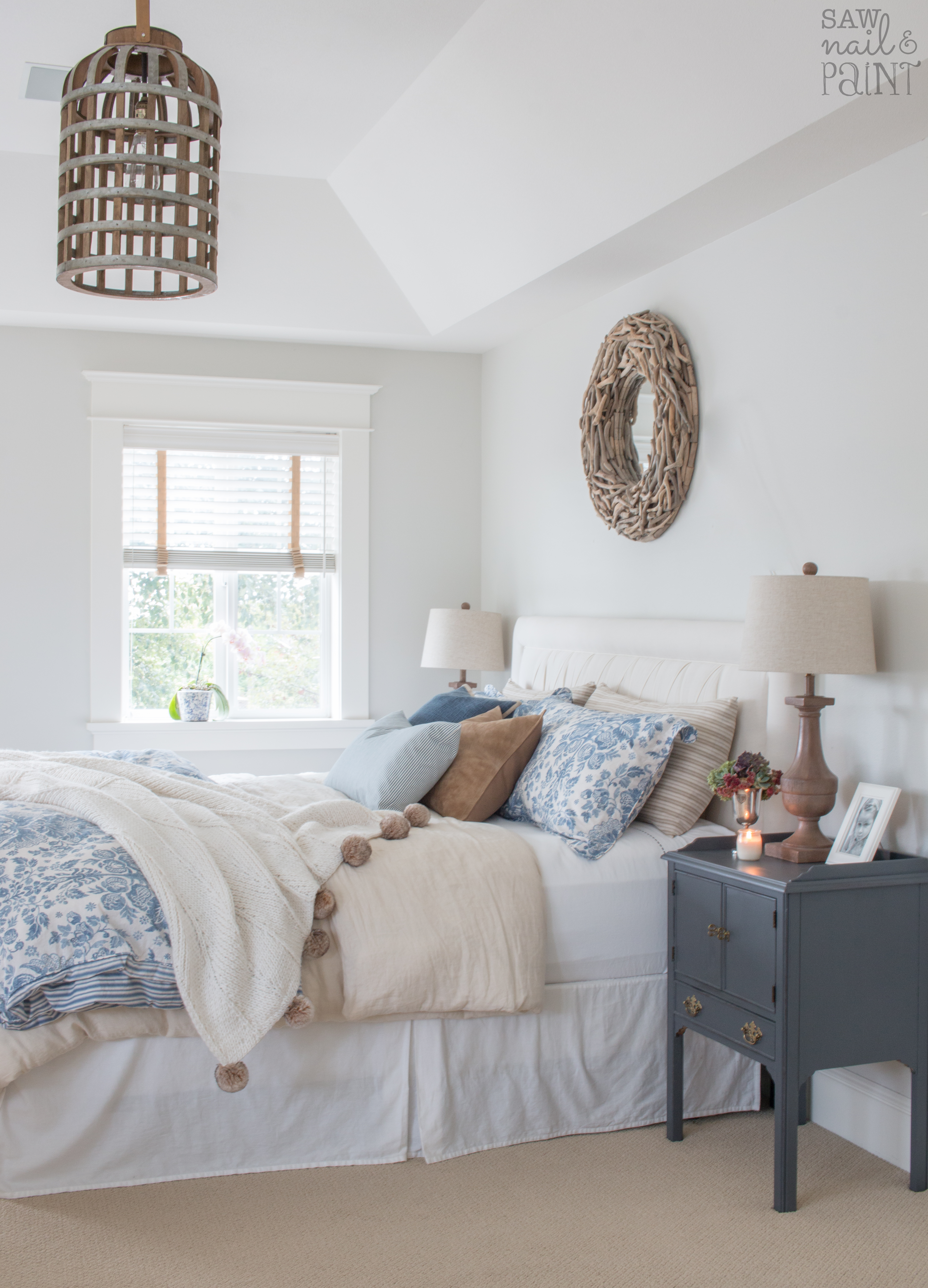 Master Bedroom With Blue And Neutral Bedding Saw Nail And Paint