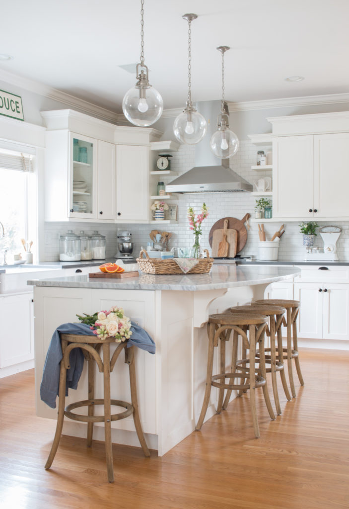 Saw Nail Paint Seattle Home Tour - Cottage Farmhouse White Kitchen Island Warm Wood Bar Stools Clear Glass Pendants