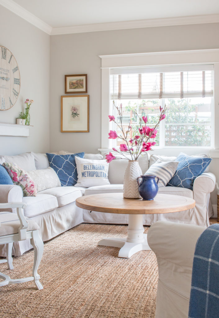 Saw Nail Paint Seattle Cottage Home Tour - Charming Living Room, Sectional Sofa, White Wood Coffee Table, Blue and Pink Accents